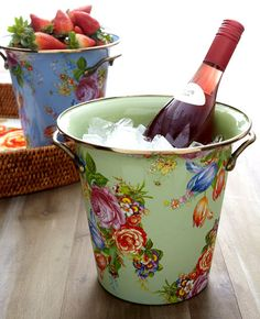 Spray paint & Mod Modge a picture, paper to the outside of a bucket. Seal well, & WALAA!! A Wine/Champagne Bucket =)