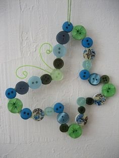 Butterfly button ornament by sknittymama, via Flickr