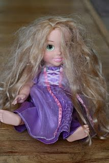 Do you have a little girl with a doll that looks like this? Restore her hair to factory condition! Great tip...works for American Girl dolls too! (This is something to remember for future reference, especially for Dad's looking to make their little girls smile)