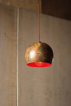 Bowl pendant lamp with red interior - love this.