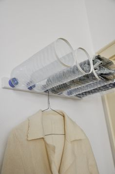 Turn plastic bottles into wall-mounted storage . . . Simple DIY: Remove bottle caps. Use small screws to attach the caps to a piece of scrap wood. Cut off the bottle bottoms and place tape around the cut area to cover sharp edges. Screw the bottles back into their caps. Hang on wall, and, voila, storage!