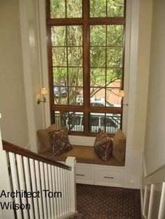 window seats like the natural wood finish with white trim