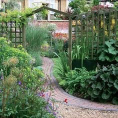 Winding brick path with wooden arch