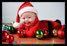 Baby - Christmas - hardwood floors and ornaments laid around