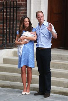 Kate Middleton and Prince William stand outside St. Mary's hospital with their new son, the Prince of Cambridge.