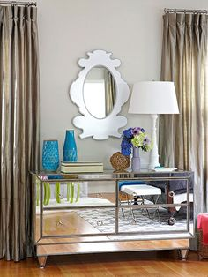 A reflective dresser makes this room feel even bigger! Try some artsy accessories in your bedroom: http://www.bhg.com/rooms/bedroom/color-scheme/blue-gray-bedroom/?socsrc=bhgpin100213artsyaccessories&page=5