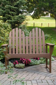 Recycled plastic outdoor dining furniture. Classic Adirondack Loveseat Bench. Perfect for the garden, patio, or any outdoor space. #MadeInUSA