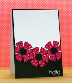 handmade card from INKlinations ... three large graphic look stamped flowers in bright reds ... fussy cut and placed on a card face of black and white ... wonderderul card!