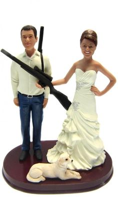 Hunting Bride and Groom w/ Shotguns Custom Wedding Cake Topper sculpted to look like the bride and groom.  You can even add your pets!