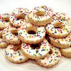 "Italian Easter Cookies | ""These are a traditional cookie from Italy flavored with vanilla and almond extracts. They are tied in loose knots and baked, then frosted with tinted icing."""