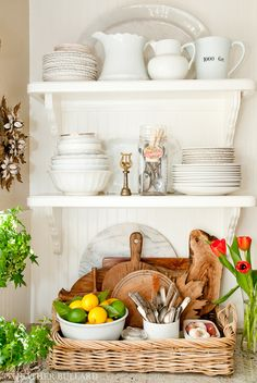 white shelves, pitchers and plates