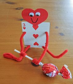"Valentine Craft from ""Heart"" cards, pipe cleaners, heart shape paper for head with wiggly eyes & lollipop!"