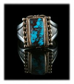 This is an awesome Bisbee Turquoise Men's Turquoise Ring created in Sterling Silver and 14ky Gold by John Hartman of Durango Silver Company.   Bisbee Turquoise is very rare and considered to be the finest Turquoise that ever came out of the ground in North America. Mining of Bisbee Turquoise ended in 1978 and it has become very scarce as well as valuable.