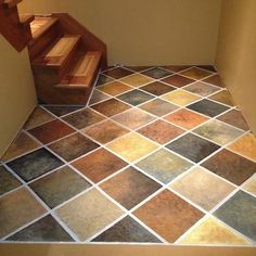 If you're unhappy with an unsightly concrete floor, paint it! This floor was painted to mimic 12-inch tiles using five different colors—gray...