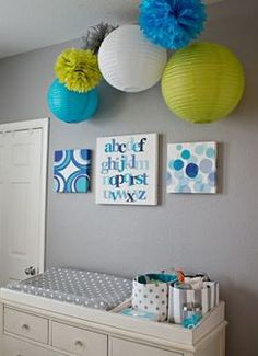 sweet nursery like the paper lanterns above change table