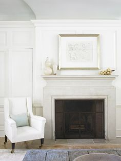 Limestone fireplace detail, concealed cabinetry, ceiling arch