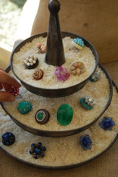 Display for rings - I like it! Use rice in tiered server --- maybe sprinkles instead to play on cupcake theme?
