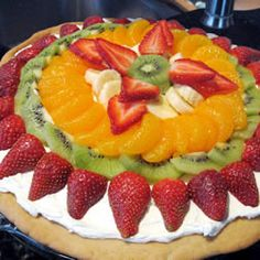 Fruit Pizza. Sugar Cookie Crust, whipped cream cheese icing and fruit. Easy and Awesome.