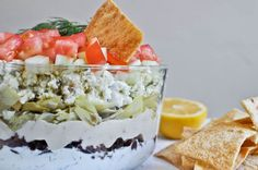 7 layer greek dip! Hummus, Kalamata Olives, Artichoke Hearts, Tomatoes, FETA! heaven <3