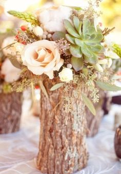 Rustic wedding centerpiece with a mix of roses and succulents