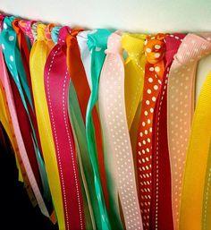 Party backdrop made from ribbon! DIY via Kara's Party Ideas karaspartyideas.com #party #backdrop #ribbon #diy #birthday #tutorial