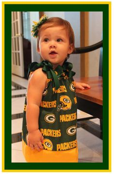 Green Bay Packers Dress Flower Headbands ... and you pick the size. $26.99, via Etsy. @wrg