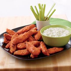 """Buffalo Chicken Tenders  """"How did we make a finger-licking chicken recipe more family-friendly? First, we replaced the traditional bone-in chicken wings with boneless strips of white meat, then we swapped in oven-baking for deep-frying. That gave us a lower-fat dish that's also easier for kids to help prepare."""""""