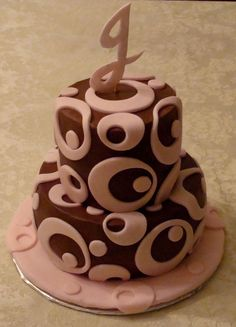Triple chocolate cake with chocolate pudding filling and chocolate butter cream and pink fondant details