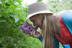Cathy smelling a Sensation lilac variety