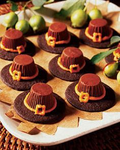 Pilgrim Hats: Chocolate cookie, peanut butter frosting and reeses peanut butter cups upside down on a thin disc of ganache as a plated dessert. #thanksgiving