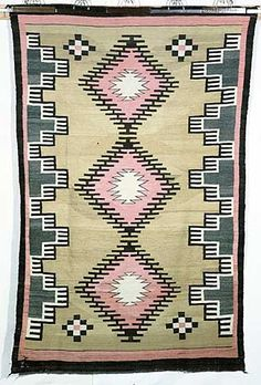 Large rectangular wool textile in a tapestry weave was probably made to sell as a rug or tapestry. It has a dark brown border with pink, brown, gold and white terraced diamond and cross designs.