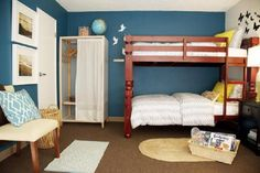Turquoise blue accent wall, red bunk beds, world globe, yellow accessories.  Vanessa De Vargas