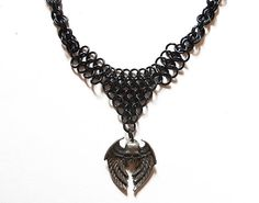 Winged skull necklace Skull with wings Black by DoBatsEatCats, $30.00