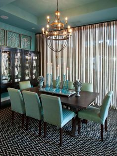 Beach-blue walls, sea glass-inspired accessories and aqua upholstered dining chairs give this dining room from HGTV Smart Home 2013 a casual elegance.