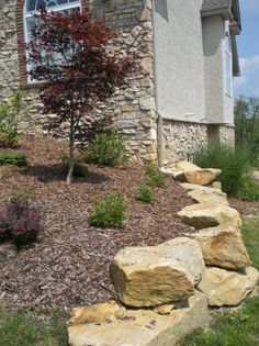 Cool way to do a short retaining wall using natural stone