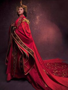 Ancient Chinese Wedding dress from the Han Dynasty. Every bride was heavily veiled and wore red to ward off demons and bad spirits.