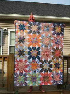 Starburst Cross Quilt.  Love the bright colors.   Peace, Robert from nancysfabrics.com
