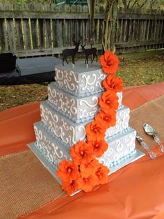 Gray and orange wedding cake. Could easily be done with navy blue and orange.
