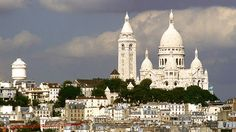 The Basilique du Sacre-Coeur (Basilica of the Sacred Heart) is a Roman Catholic Church and popular landmark in Paris, France, located at the summit of the Montmartre (Martyrs' Mount) hill.