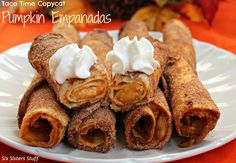 Pumpkin Empanadas- one of our favorite fall treats! Rolled in cinnamon and sugar . . . these are GOOOOD! :) SixSistersStuff.com #pumpkin #recipe #dessert