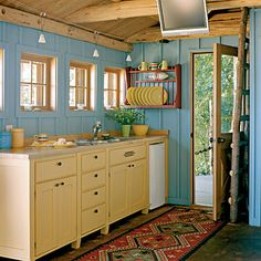"""Bright and Beautiful    This sunny kitchen is sunny without feeling overwhelming. """"My decorating sense was influenced more by Crayola than anything else,"""" says homeowner Sue Hoffman."""