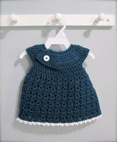 Newborn crochet dress! Very easy and made in one piece. (Used the linked free pattern with one adjustment: I didn't care for the join being in the front of the dress so on the last row of the bodice, continue with 4 hdc, and 10 sc to the side of the dress and resume the V/shell stitches skirt part as written.)