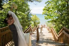 Lake Michigan beach Wedding photo Northern Michigan near Bellaire and Torch Lake by Paul Retherford Wedding Photography #weddingidea #musthaveweddingphoto #weddingpic #weddingday #ido #nomiweddings #nomiphotographer #puremichigan