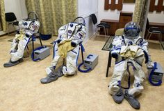 Space suits of U.S. astronaut Joseph Acaba (L) and Russian cosmonauts Gennady Padalka (C) and Sergei Revin are ready for a crew's training session at the Star City space center outside Moscow April 24, 2012. The three-man team is preparing for a mission to the International Space Station on May 15.