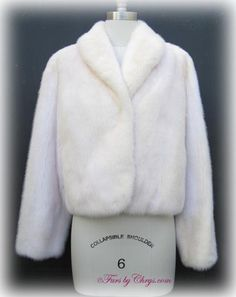 White Mink Short Jacket #WM713;Very Good Condition; 8 - 12. This is a stunning genuine natural white mink fur jacket in a sassy, short length. It has a Henig Furs label and features a shawl collar. This white mink jacket is perfect for when the air is chilly, but a full-length fur is just too much. Dreams are made of this!