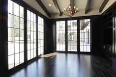 The dark woods, beams, and industrial-inspired Colton Chandelier with dark floors