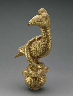 AKAN   Ghana or Côte d'Ivoire   Sword Handle of a Bird and Snake   Late 19th century   Wood and gold leaf                                                          Ghana or Côte d'Ivoire                                                    Sword Handle of a Bird and Snake                                          Late 19th century                                    Wood and gold leaf