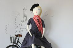 Gigi is inspired by the French Fashion of the 1950s    * Dolls is 23 in length.  * For the body I used 100% cotton fabric.  * For the hair I recycle