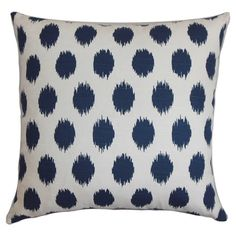 Cotton pillow with an ikat dot motif and feather-down fill. Made in the USA.   Product: PillowConstruction Material...