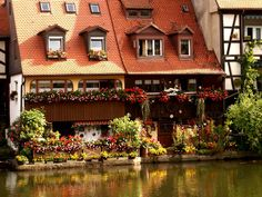 Klein-Venedig river area cottage and its flower box display in Bamberg Germany